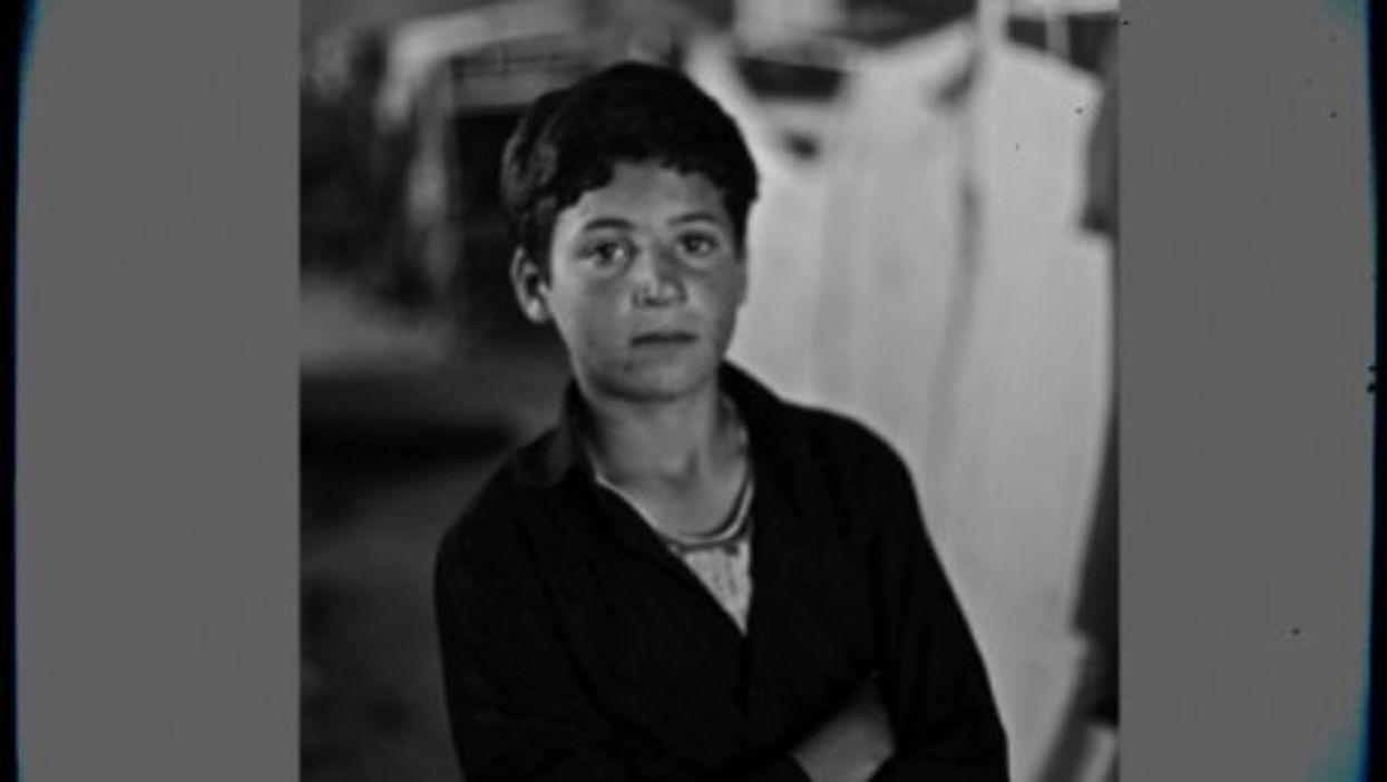 A 14-year-old Syrian boy inside the al-Ramtha refugee camp
