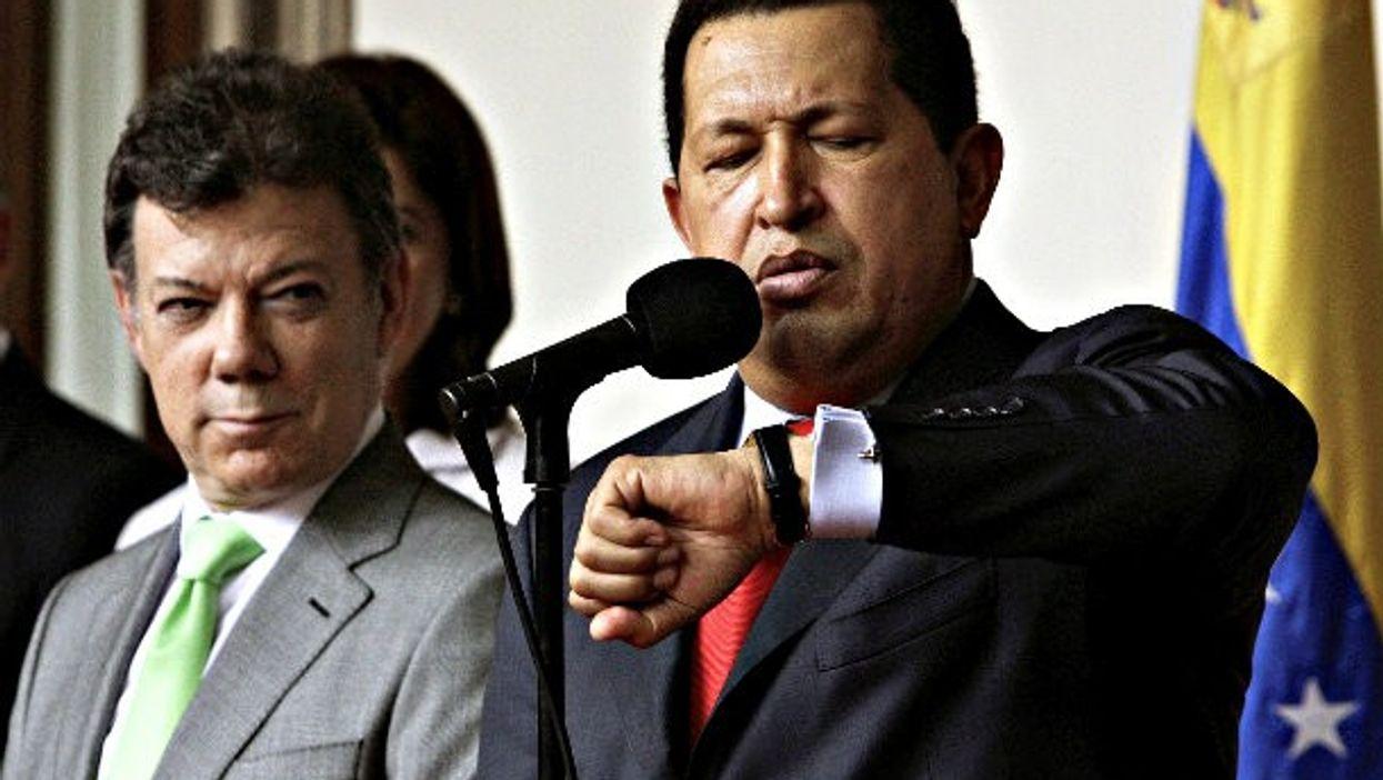 A 2010 photo of Juan Manuel Santos and late Venezuelan President Hugo Chavez