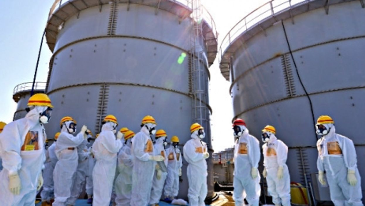 A 2013 visit to Fukushima by Japanese PM Shinzo Abe (in red helmet)