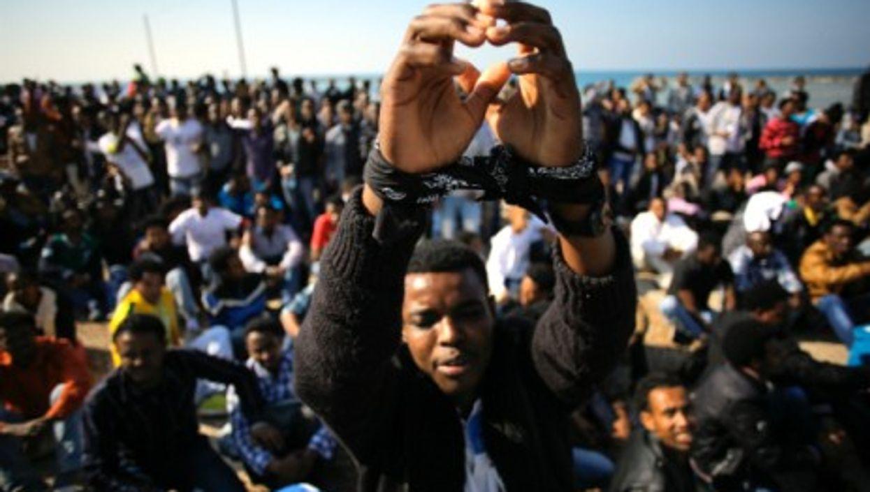 A 2014 protest in Tel Aviv, as immigrants demand asylum .
