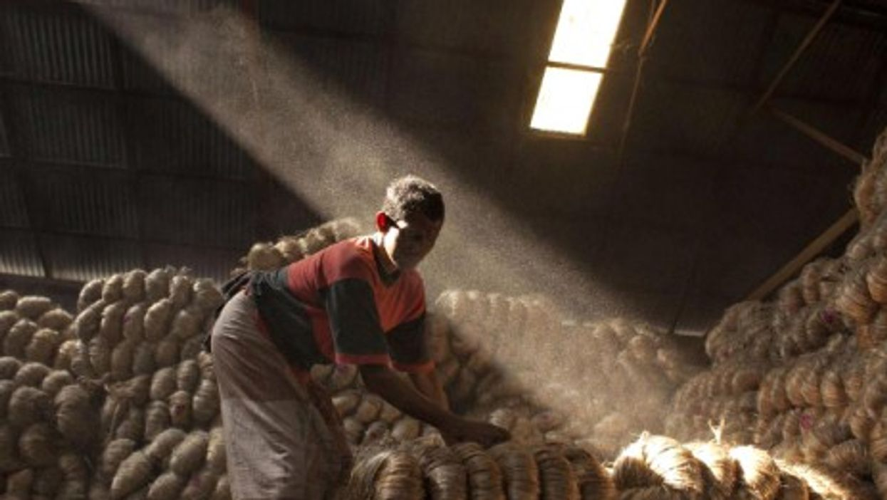 A Bangladeshi man is working inside a jute warehouse on the outskirts of the country's capital Dhaka.
