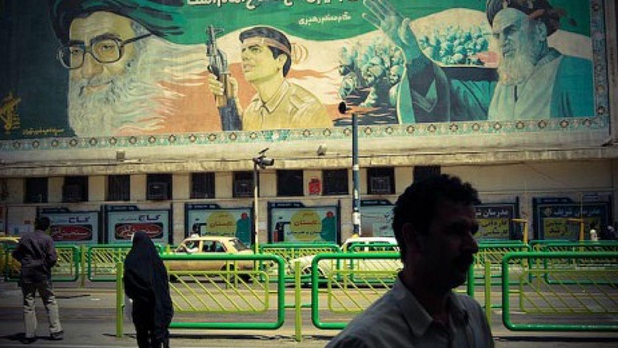 A billboard celebrating the leaders of the revolution in Tehran