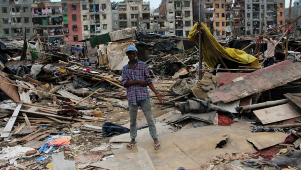 A boy at the site of demolished slum dwellings At Okhla In New Delhi