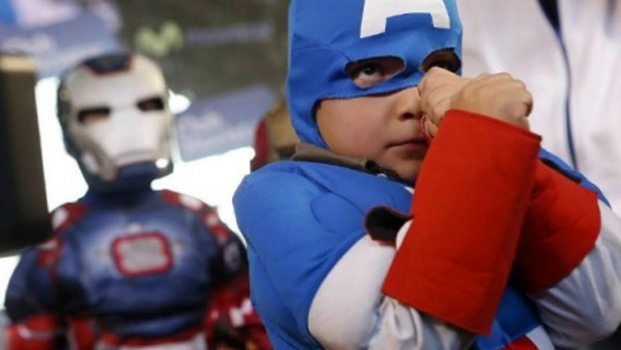 A boy dressed as Captain America strikes a pose at the fourth annual Comic Con Chile in Santiago.