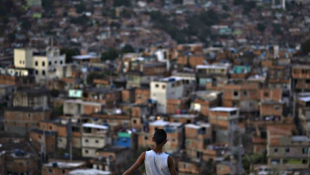 A boy looking at a Rio favela