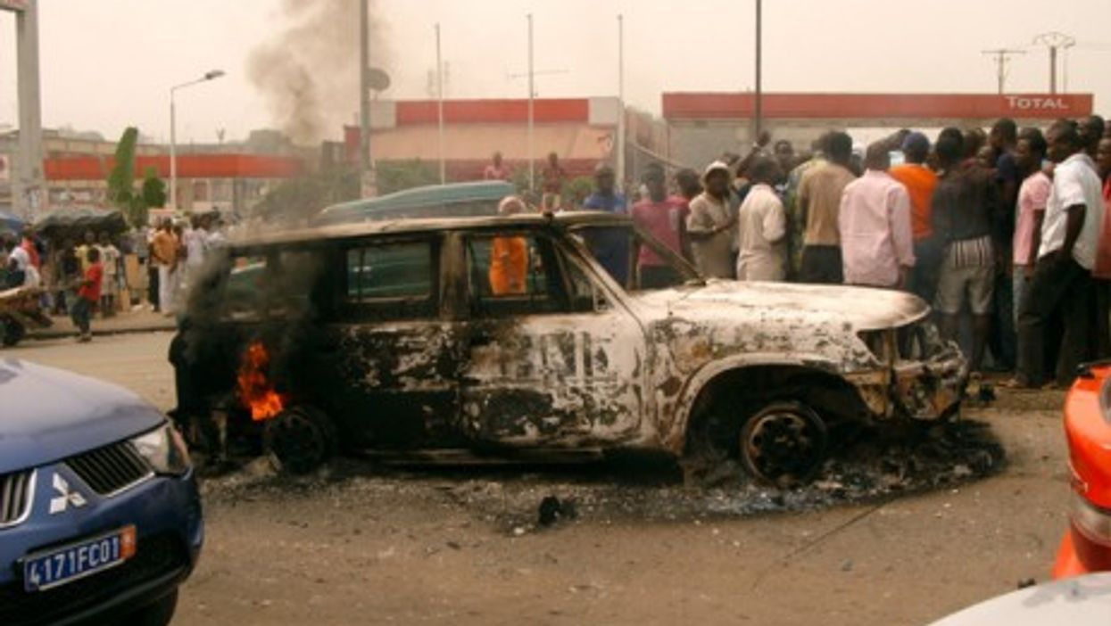A burned out car in Abidjan earlier this year