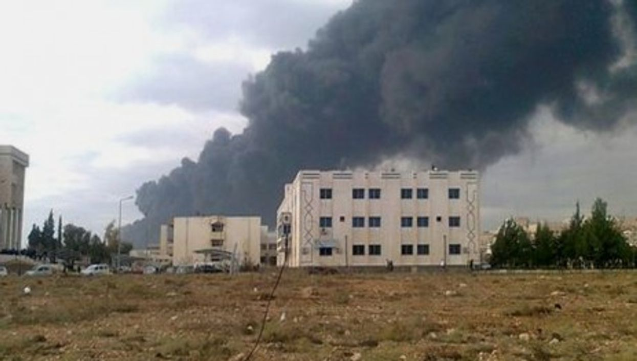 A burning building in Homs on Jan. 20, 2012 (FreedomHouse)