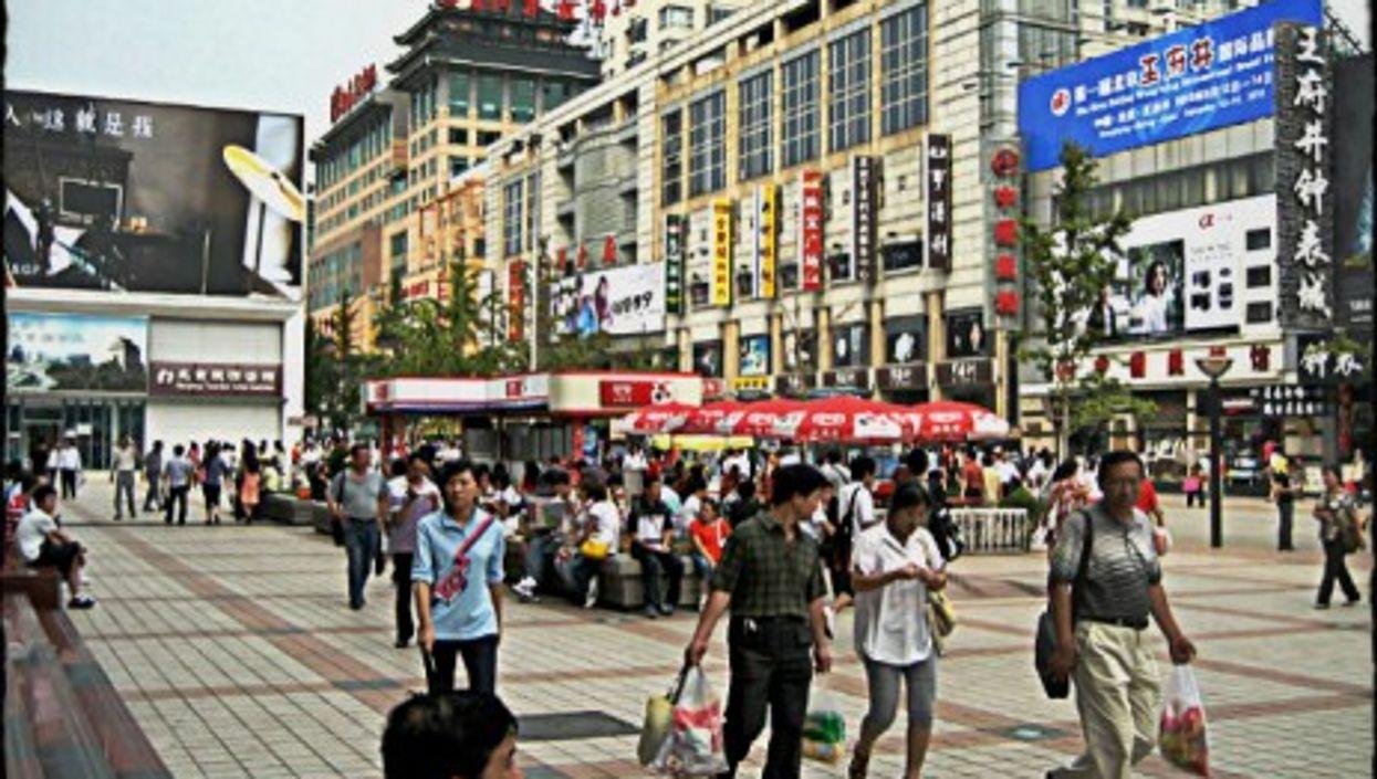 A busy shopping street in Beijing