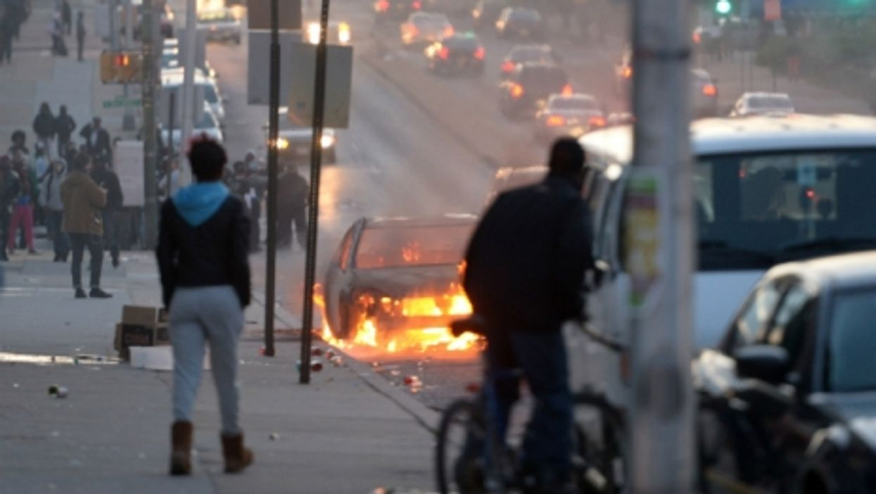 A car burning on the streets of Baltimore