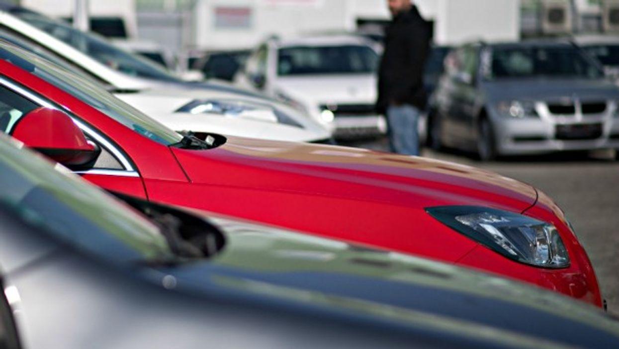 A car salesman looking over used diesel cars in Stuttgart, Germany
