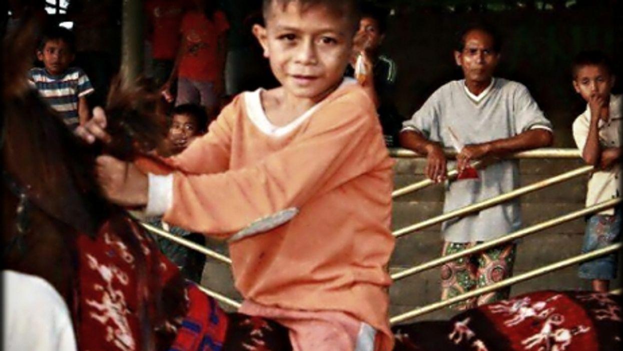 A child jockey in Indonesia