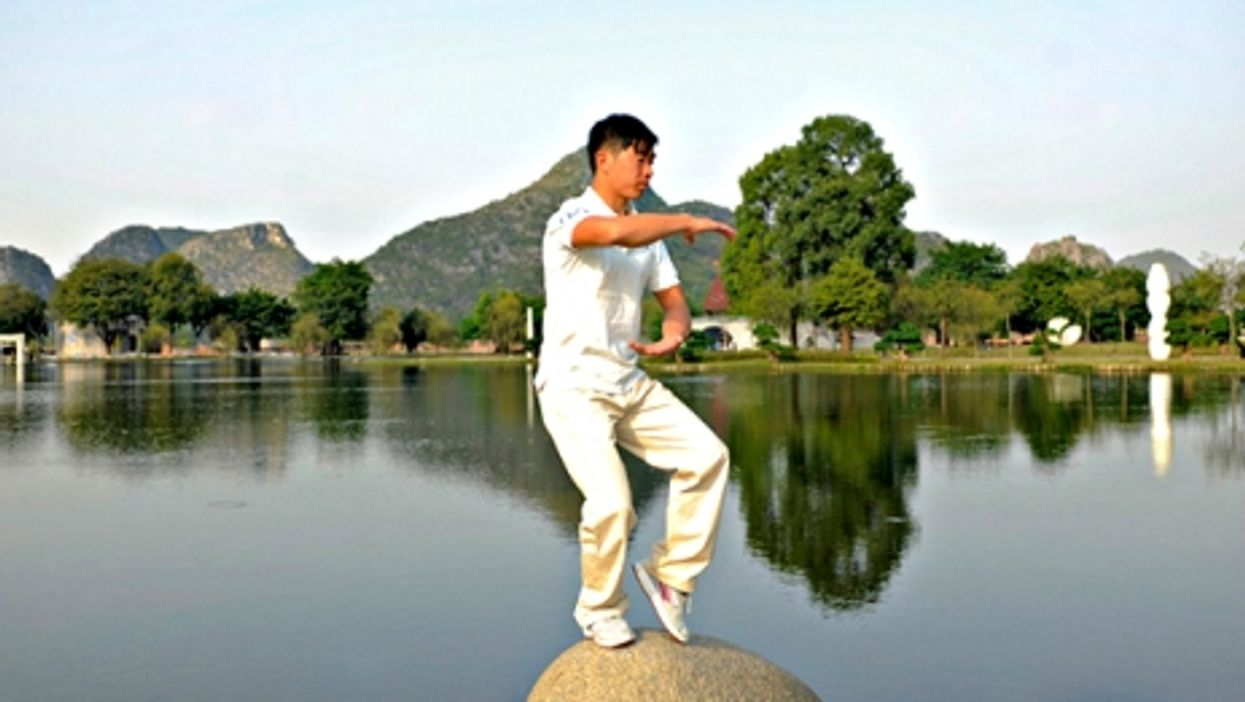 A Chinese GO giving a tai-chi class in Guilin
