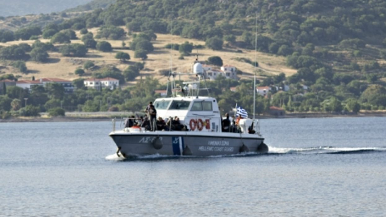 A coast guard boat carrying rescued refugees approaching the Greek island of Lesbos