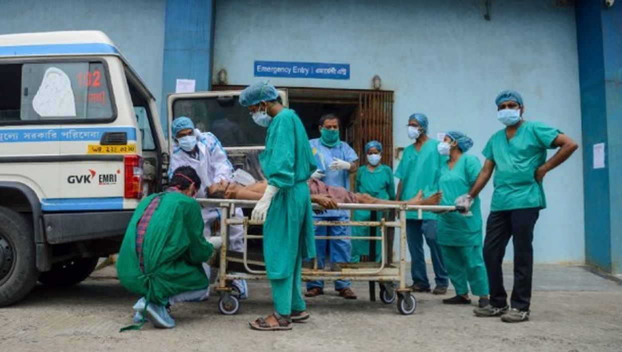 A critical COVID patient is taken to a COVID care hospital, in Kolkata, India, in April 2021.
