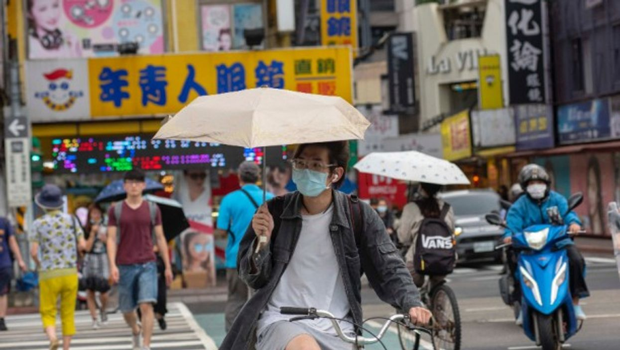 A cyclist wearing a mask near the National Taiwan University in Taipei