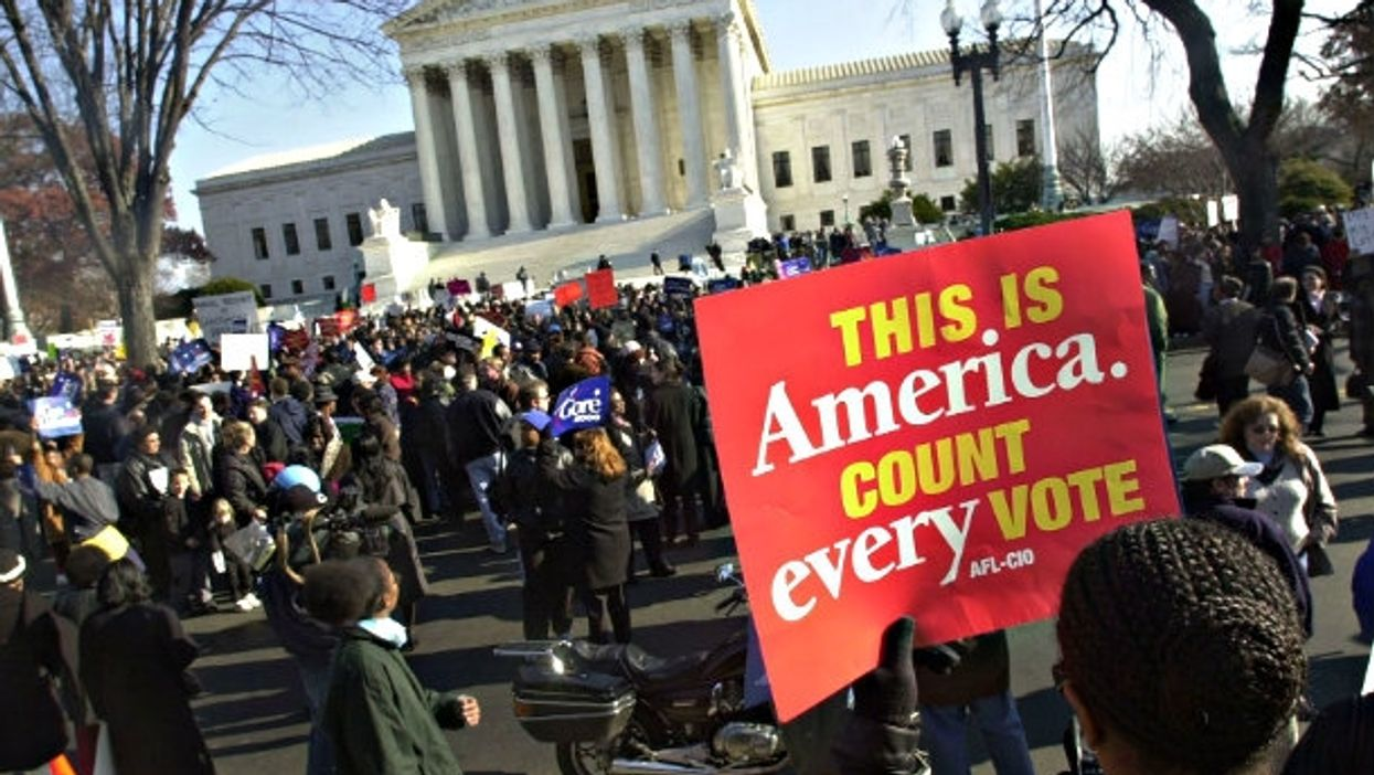 A December 2000 file photo shows Supreme Court protests before Bush v. Gore decision.