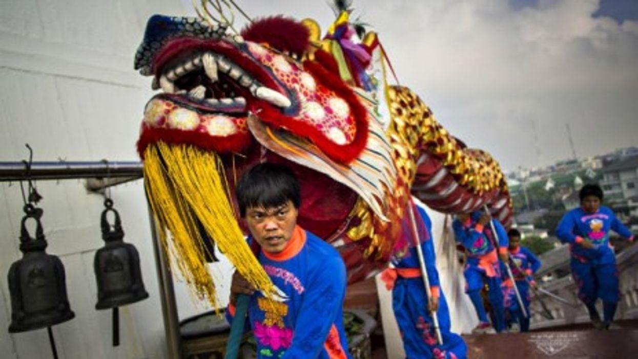 A dragon parade marks the start of the Wat Saket temple fair in Bangkok