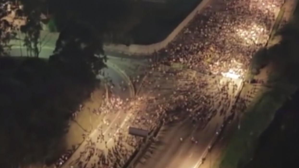 A drone captures Brazilian demonstrators massing below