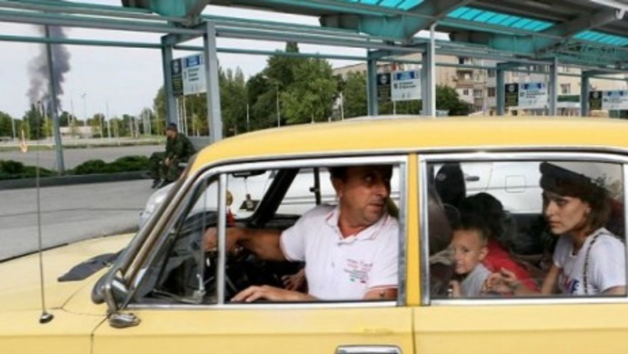 A family flees the Donetsk area as intense fighting continues in the city.