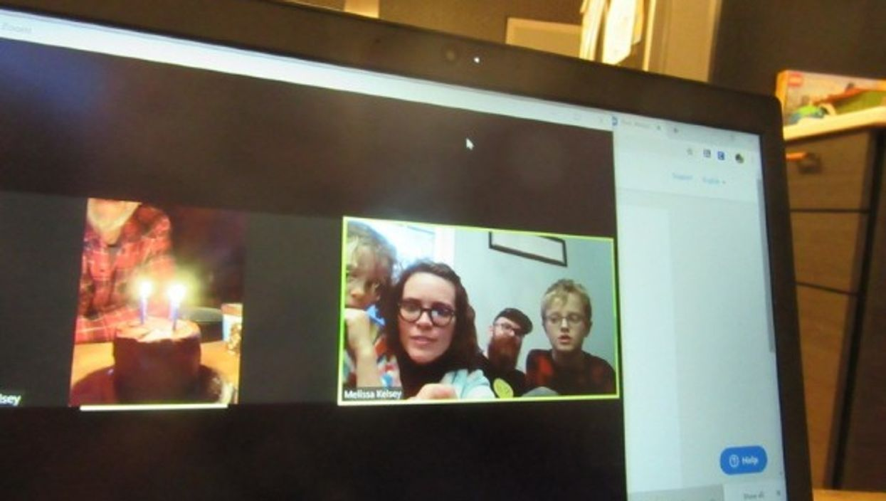 A family wishing happy birthday to their grandfather through video call.