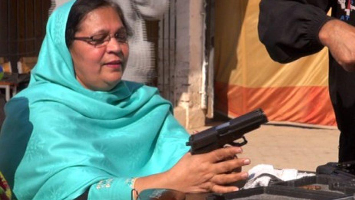 A female teacher trying a gun.