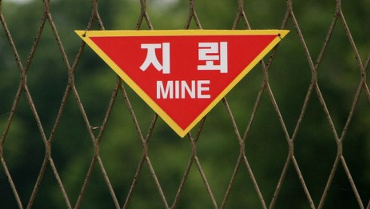 A fence along the DMZ (Demilitarized Zone) separating North and South Korea (Ben Kucinski)