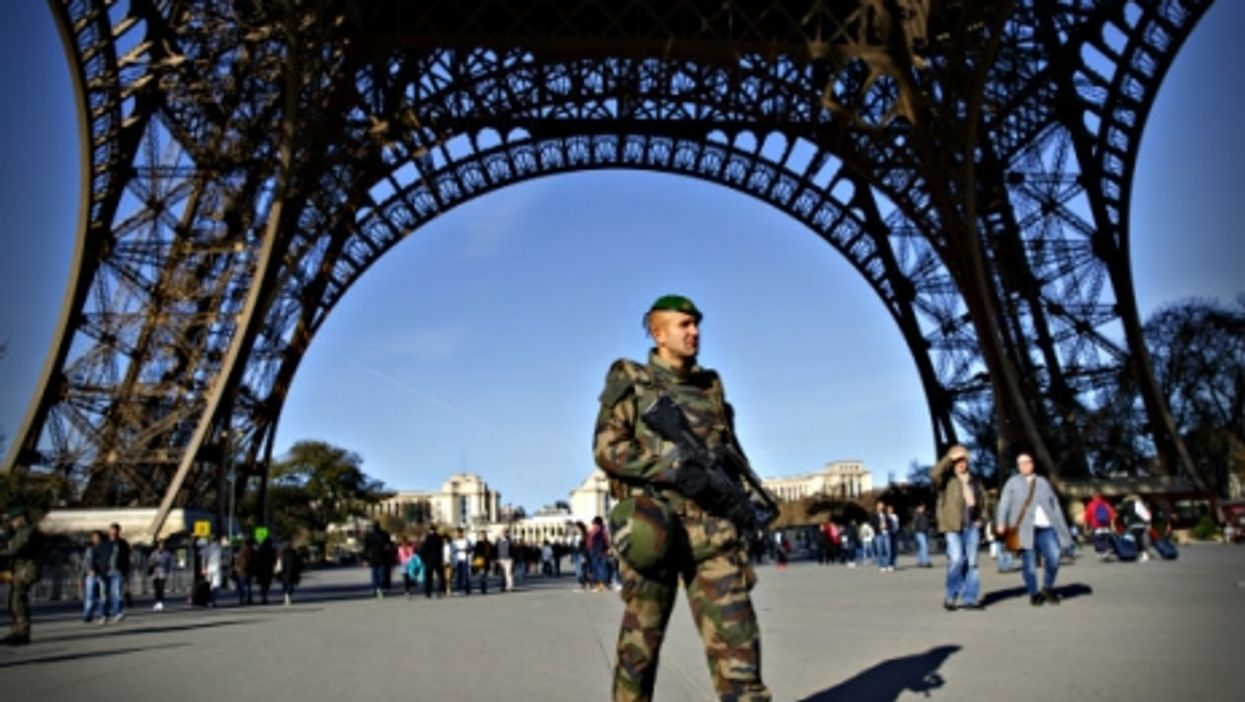 A French soldier patrolling the Eiffel Tower on Monday