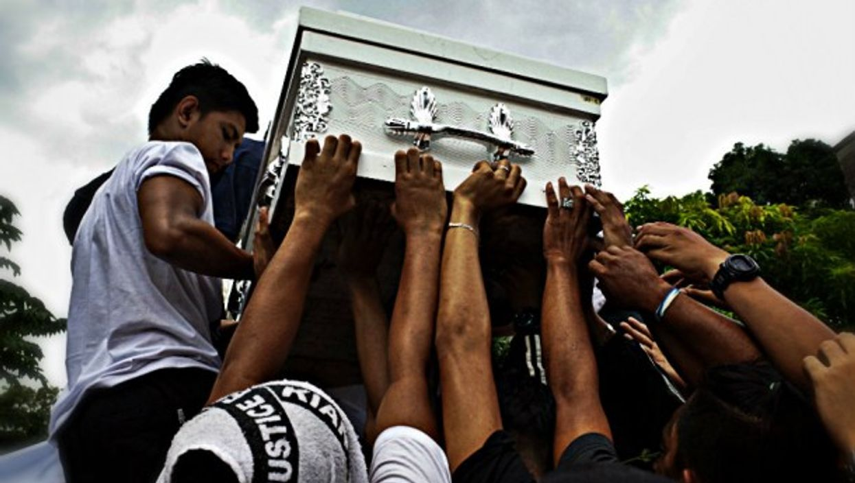 A funeral earlier this year for a teenager killed by police in Manila .