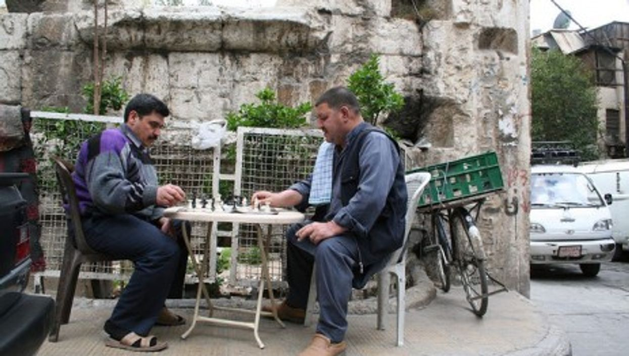 A game of chess near the Roman ruins of Temple of Jupiter in Damascus