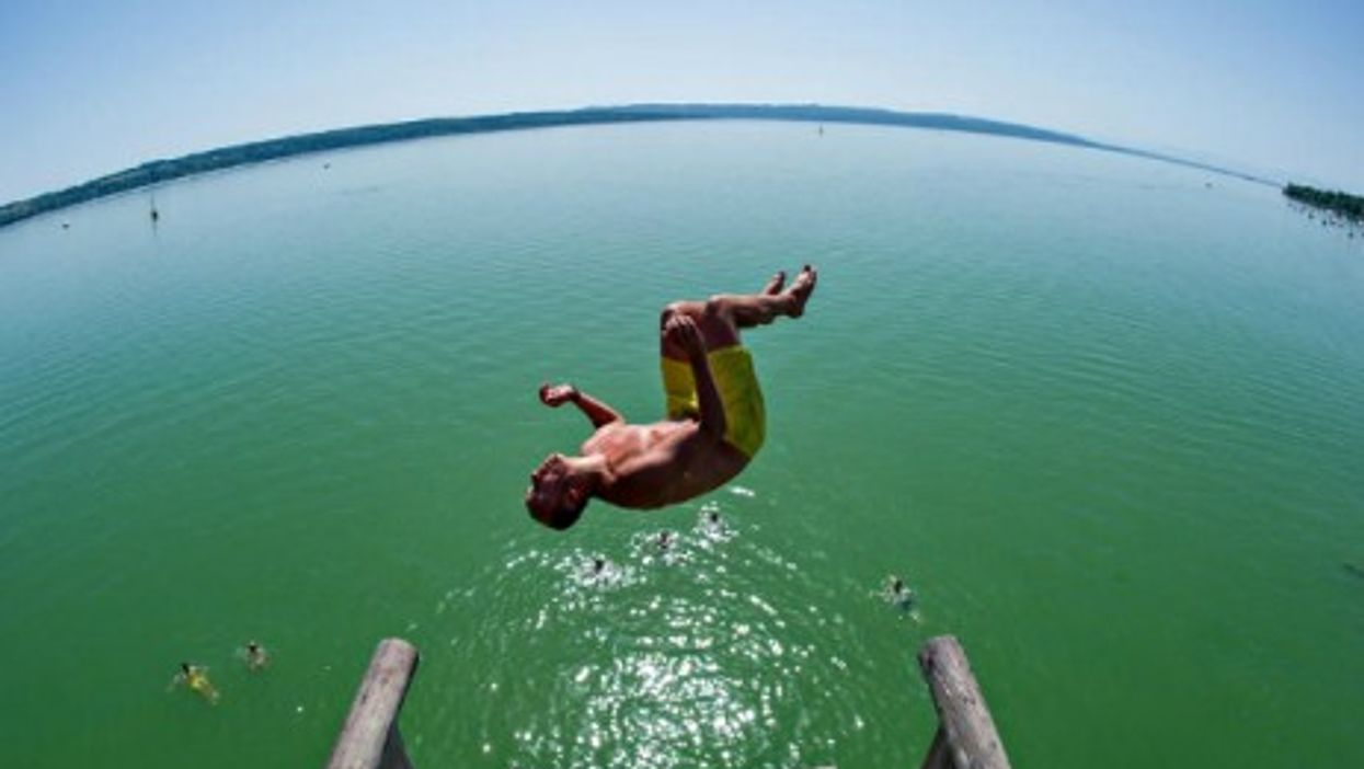 A German daredevil enjoys the wave of warm weather that hit most of Europe on Monday.