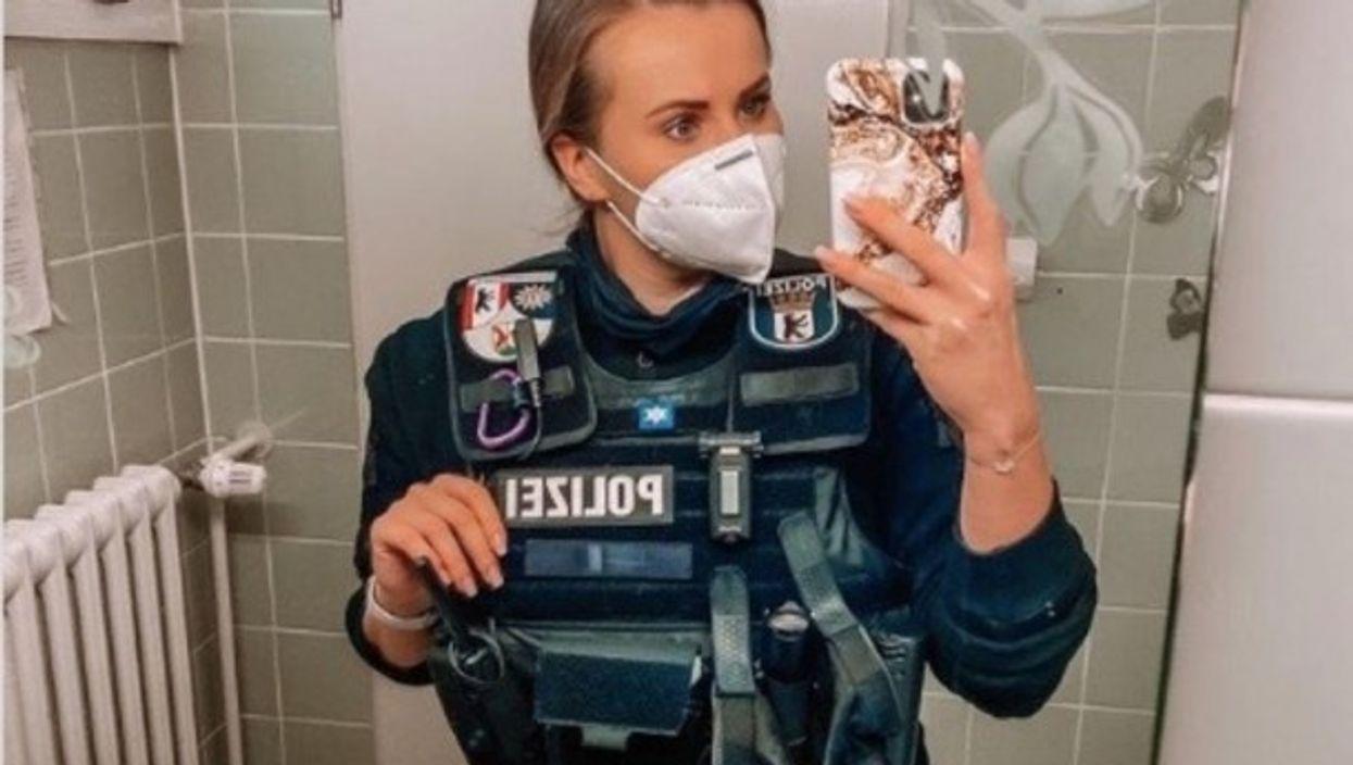 A German police officer taking a selfie.