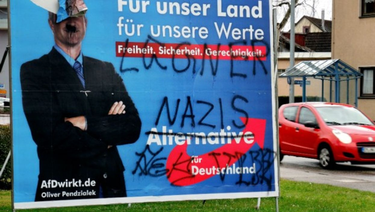 A graffitied AfD poster