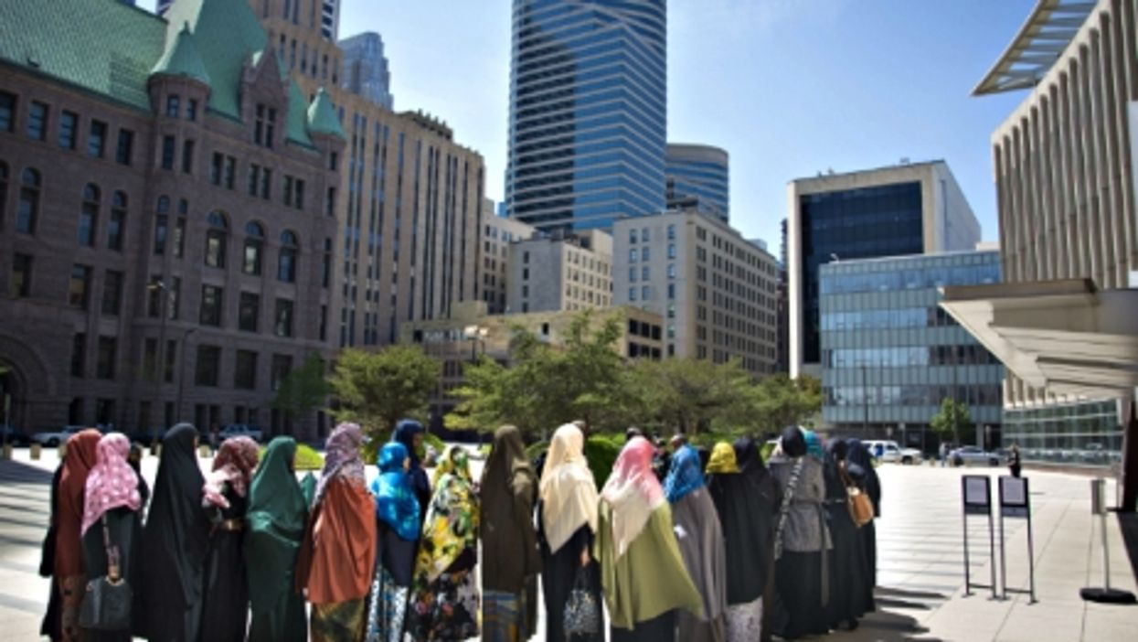 A group of Somali women wait outside Minneapolis' Federal Courthouse