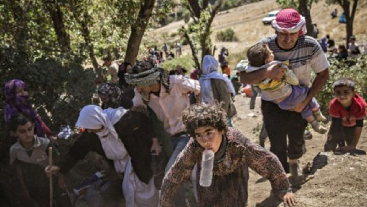 A group of Yazidis Kurds, mostly women and children, arrive at a village in Sirnak, Turkey.