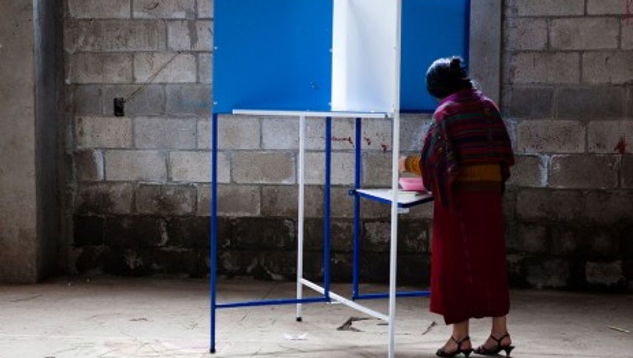 A Guatemalan woman votes in September's first-round election