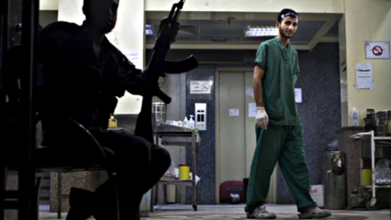 A gunman inside a hospital in Aleppo, Syria