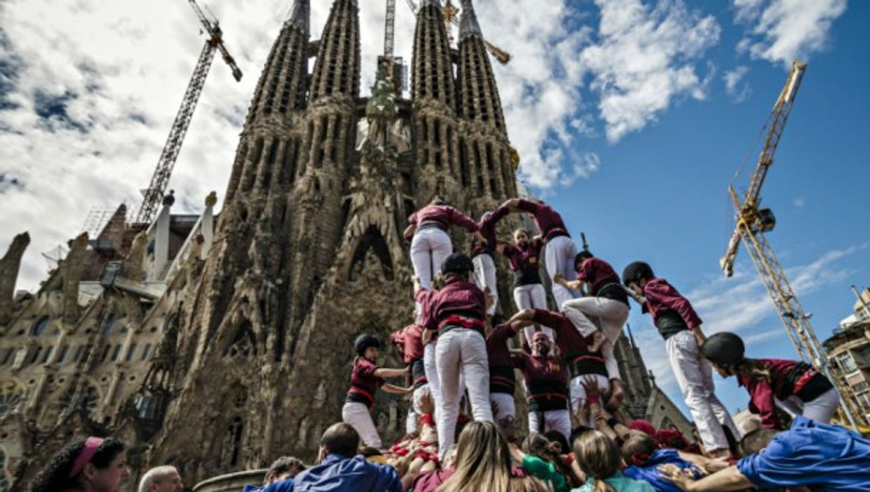 A human tower in front of the Sagrada Familia