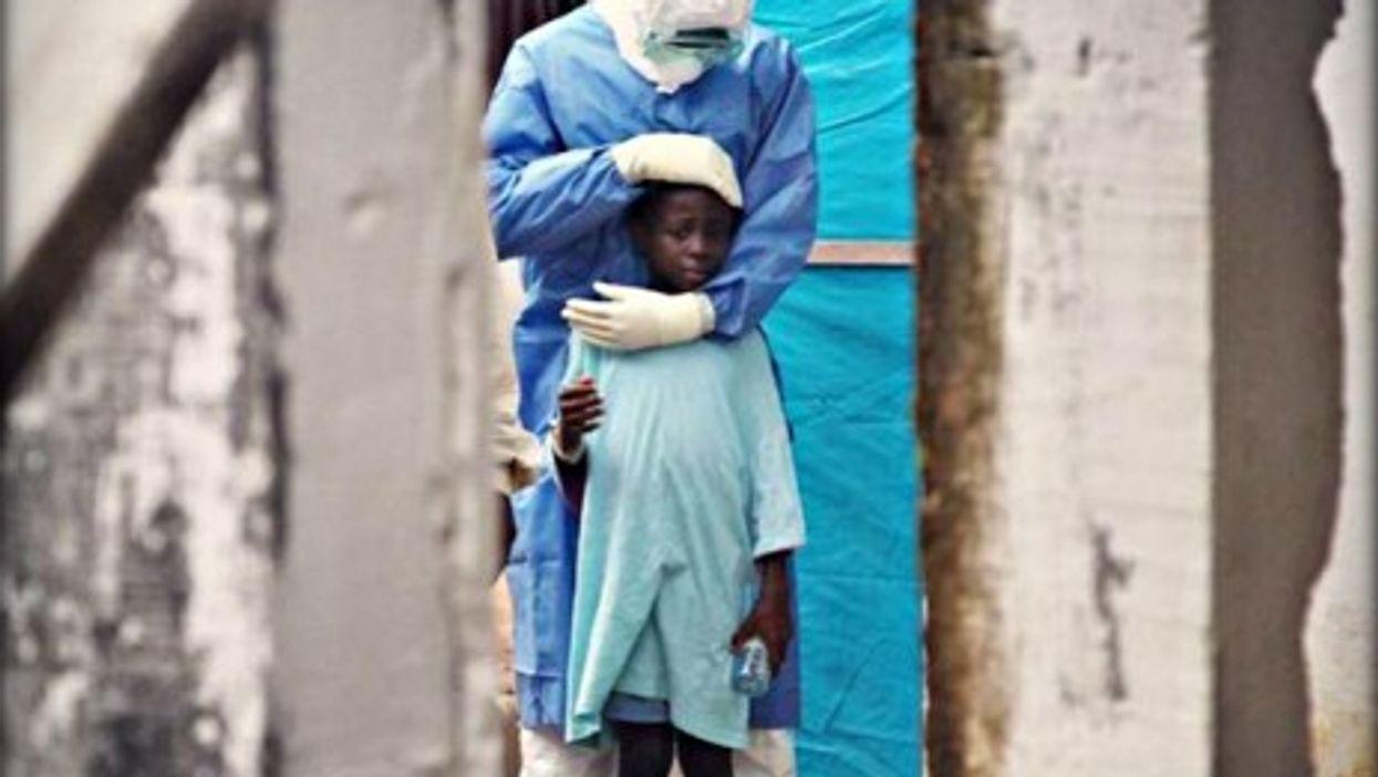 A humanitarian aid worker with an Ebola survivor