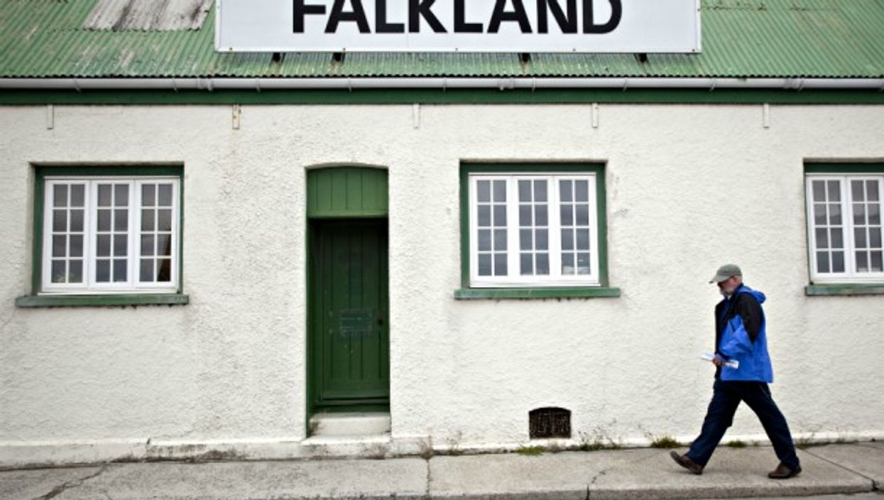 A man passes by a store in the Falklands