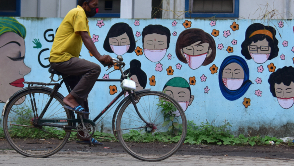 A man riding a bicycle  in India's Nagaon district,, June 11, 2021.