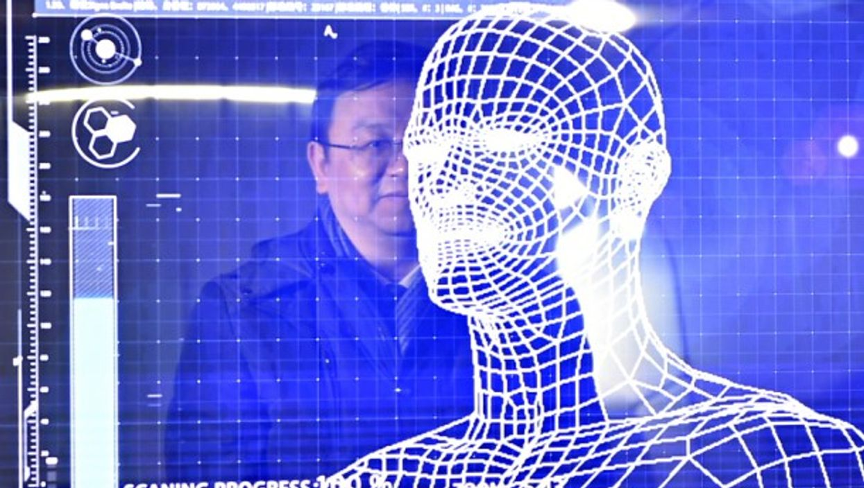 A manager of the BYD company tries the facial recognition in a 'Yungui' train in Yinchuan, China on January 10