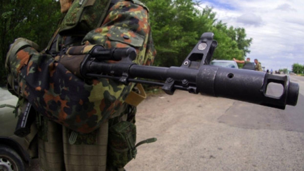 A masked pro-Russian rebel in Ukraine last year