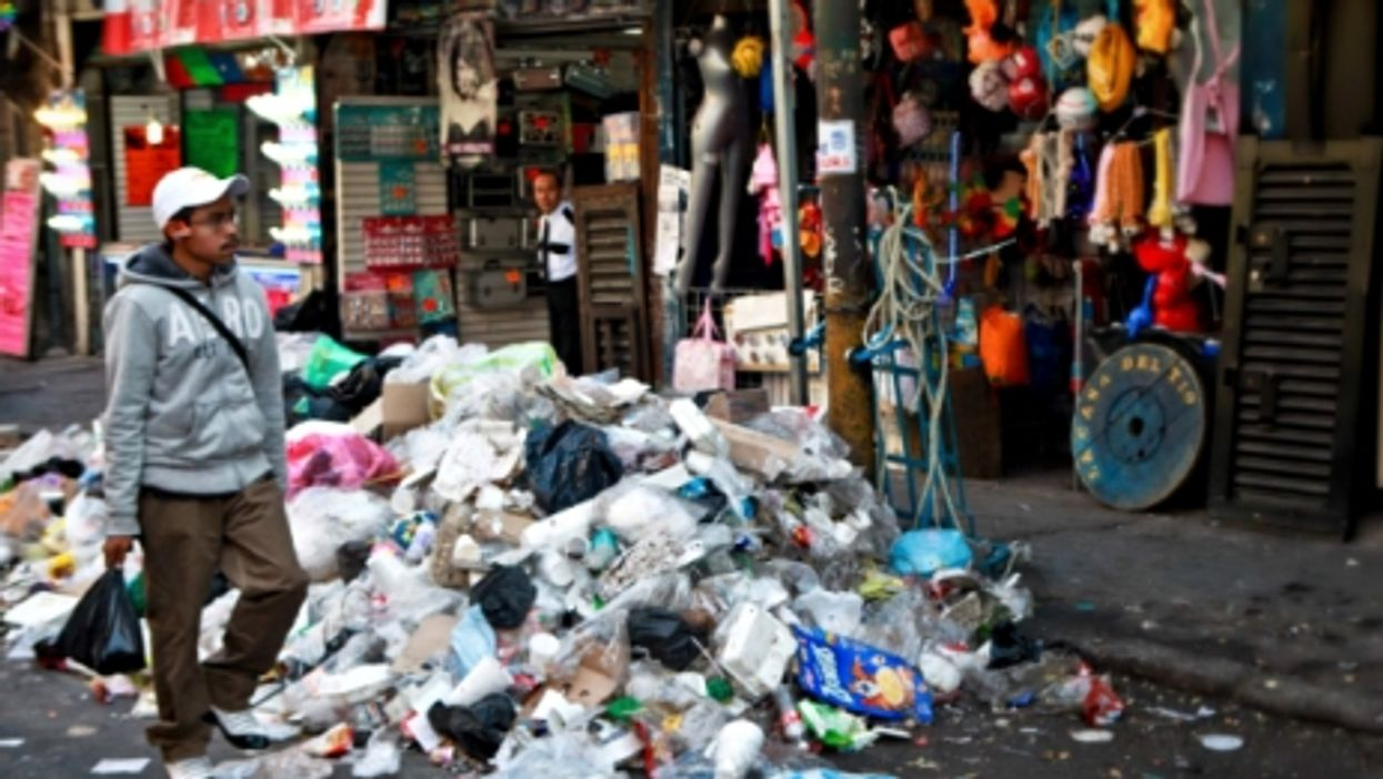 A Mexico City street littered with trash
