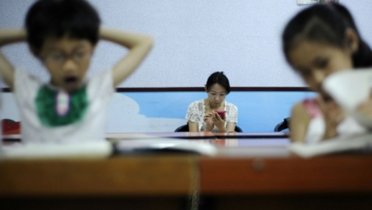 A mother waiting for her children during a music class in Yinchuan