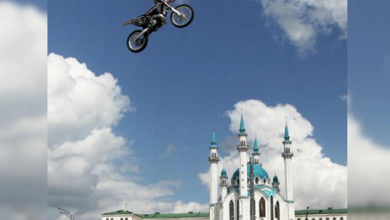 A motorcycle rider soars at the 2014 Kazan City Racing show in Millenium Square in Kazan, Tatarstan.