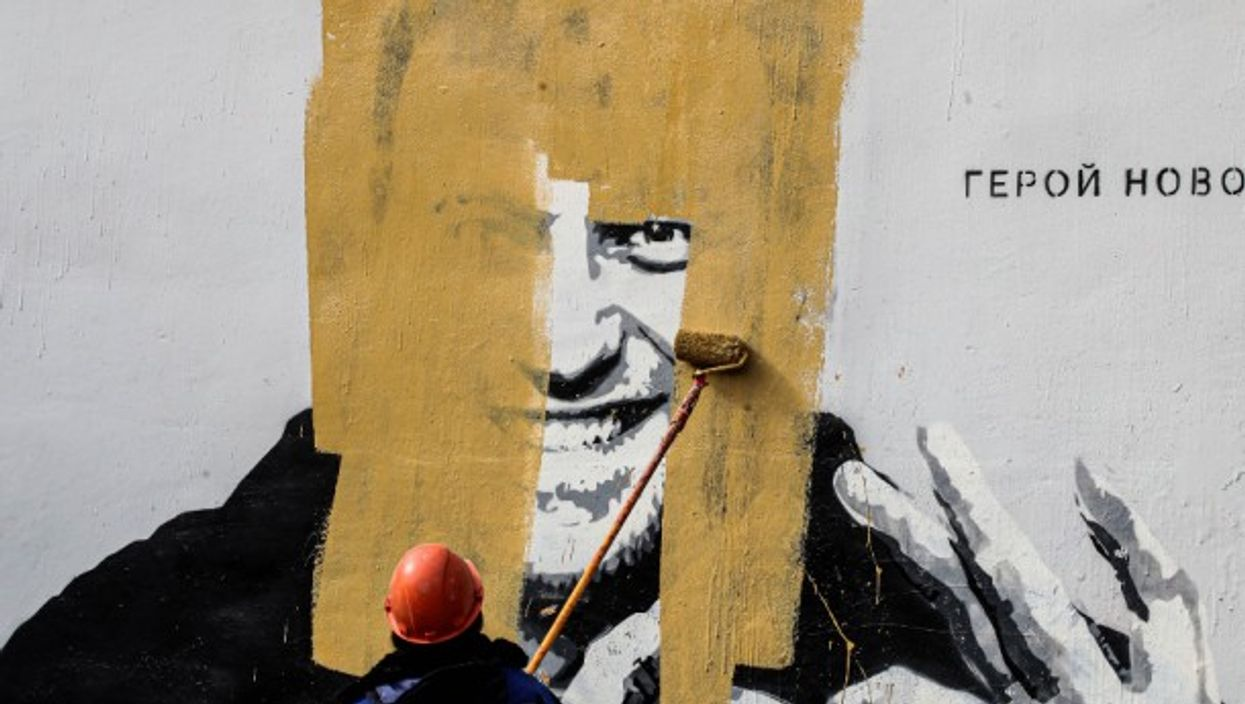 A mural depicting Russian Putin critic Alexei Navalny is being painted over less than 90 minutes after it was discovered on Wednesday in Saint Petersburg.