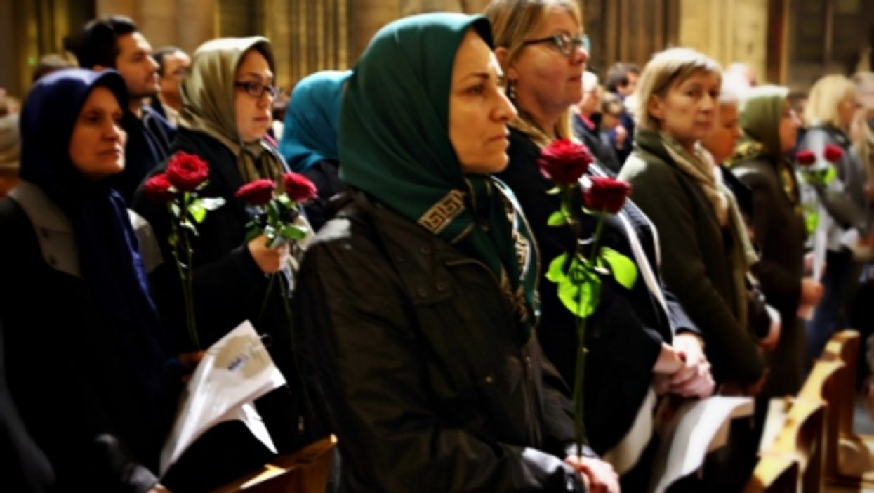A Muslim women in the Notre Dame cathedral during a memorial service for the victims of the Paris attacks on Nov. 15