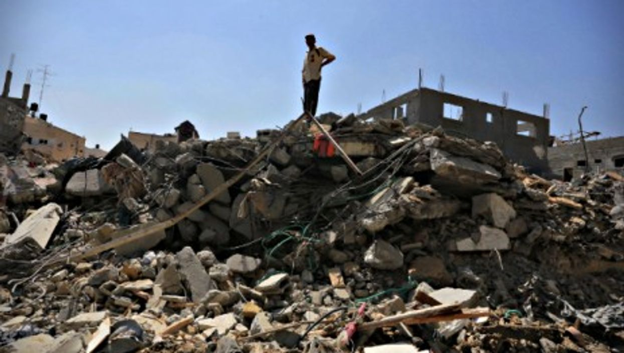 A Palestinian man stands amid ruins in Beit Hanoun in the northern Gaza Strip