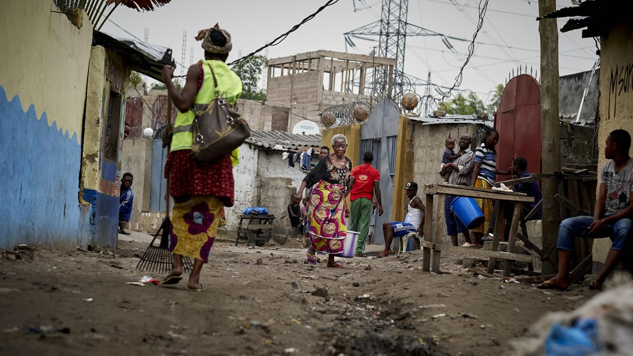 A photo of two women on a dirt road in Kinshasa.