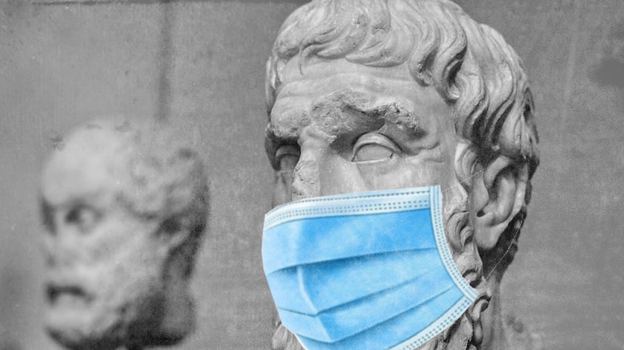 A photomontage of a bust of Greek philosopher Epicurus with a COVID-19 facemask